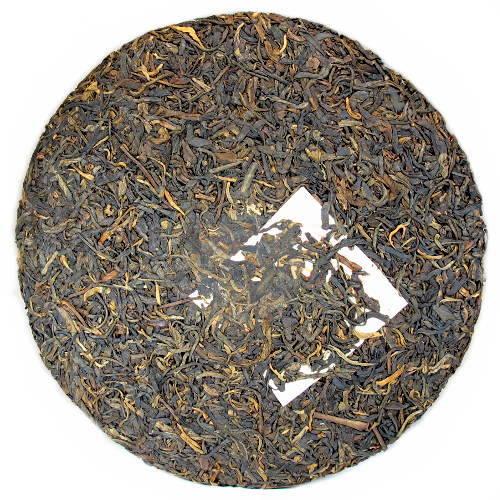 Galette entière de thé pu-erh 8582 millésime 2002 affinage Hong Kong